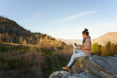 Woman with laptop on the mountain Stock Photo