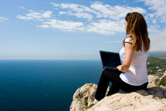 Woman with laptop and nature Stock Images