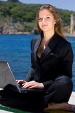 Woman with laptop near the  sea Royalty Free Stock Photo