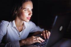 Woman with laptop at night Stock Photos