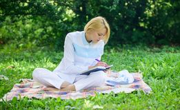 Woman with laptop or notebook sit on rug green grass meadow. Business picnic concept. Steps to start freelancing royalty free stock images
