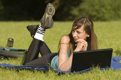 Woman with laptop outdoor Royalty Free Stock Images