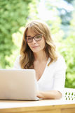 Woman with laptop outdoor Stock Photos