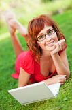 Woman with laptop outdoors Royalty Free Stock Images