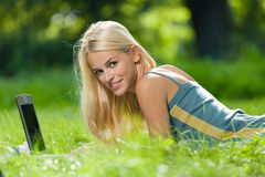 Woman with laptop, outdoors Royalty Free Stock Images