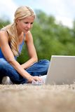 Woman with a laptop outdoors Royalty Free Stock Images