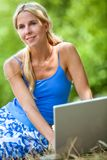 Woman with a laptop outdoors Stock Photo