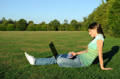 Woman with laptop outdoors Royalty Free Stock Image