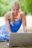 Woman with a laptop outdoors Royalty Free Stock Photo