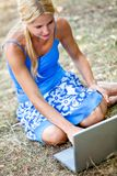 Woman with a laptop outdoors Royalty Free Stock Photos