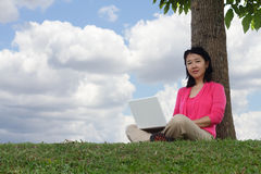 Woman with laptop outdoors Stock Photos