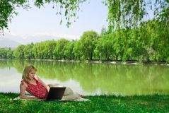 Woman with laptop outdoors Royalty Free Stock Photography