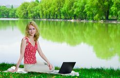 Woman with laptop outdoors Stock Photography