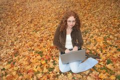 Woman on laptop outdoors Royalty Free Stock Image
