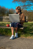 Woman with a Laptop Outdoors royalty free stock image