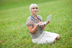 Woman with laptop outside Royalty Free Stock Photos