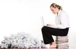 Woman, laptop and paperwork Royalty Free Stock Photo
