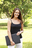 Woman with laptop at park Stock Photography