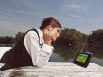 A woman with laptop in park Stock Photo