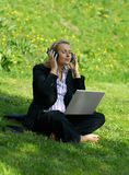 Woman with laptop in park Royalty Free Stock Photo