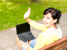 Woman with laptop in the park Stock Photography