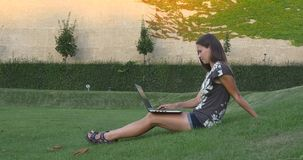 Woman with a laptop and a pattern on the wall stock footage