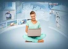 Woman with laptop pc and virtual screens. Technology, internet, tv and news concept - young women with laptop pc and virtual screens Stock Images