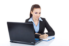 Woman with laptop and pen Stock Photos