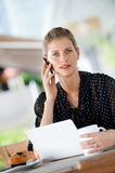 Woman With Laptop and Phone Royalty Free Stock Image