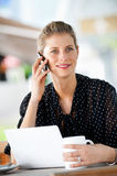 Woman With Laptop and Phone Stock Images