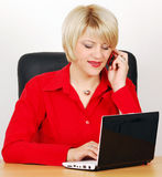 Woman with laptop and phone Stock Image