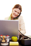 Woman with laptop on the phone Royalty Free Stock Photography