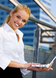 Woman with laptop Stock Photos