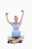 Woman with laptop raising her hands Stock Photo
