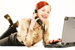 Woman with laptop and receiver Royalty Free Stock Photography