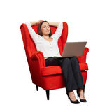 Woman with laptop on the red chair Stock Images