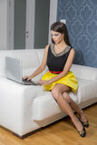 Woman with laptop in the room. Young woman with laptop in the room Stock Photos