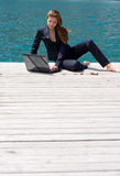 Woman with laptop and sea Royalty Free Stock Images