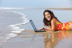 Woman with laptop in sea Stock Image