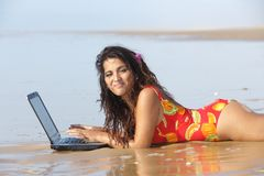 Woman with laptop in sea Stock Images