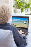 Woman laptop searching holiday trip royalty free stock images