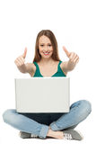 Woman with laptop showing thumbs up Stock Photos