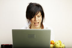 Woman with laptop singing Stock Photo