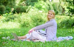 Woman with laptop sit grass meadow. Best jobs to work remotely. Stay free with remote job. Business lady freelance work stock photo