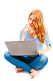 Woman with laptop sitting on white background Royalty Free Stock Image