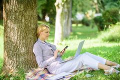 Woman with laptop and smartphone working outdoors. Girl use modern technology for business. Modern technology give more royalty free stock photography