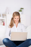Woman With Laptop On Sofa Royalty Free Stock Image
