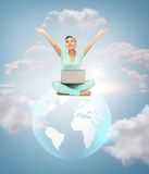 Woman with laptop and sphere globe Stock Images