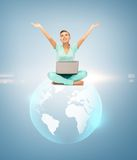 Woman with laptop and sphere globe Stock Photo