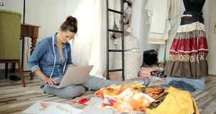 Woman with laptop in tailor`s shop stock footage